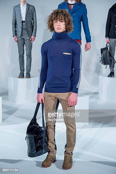 A model poses at the David Naman Presentation during NYFW Men's at Dune Studios on January 30 2017 in New York City