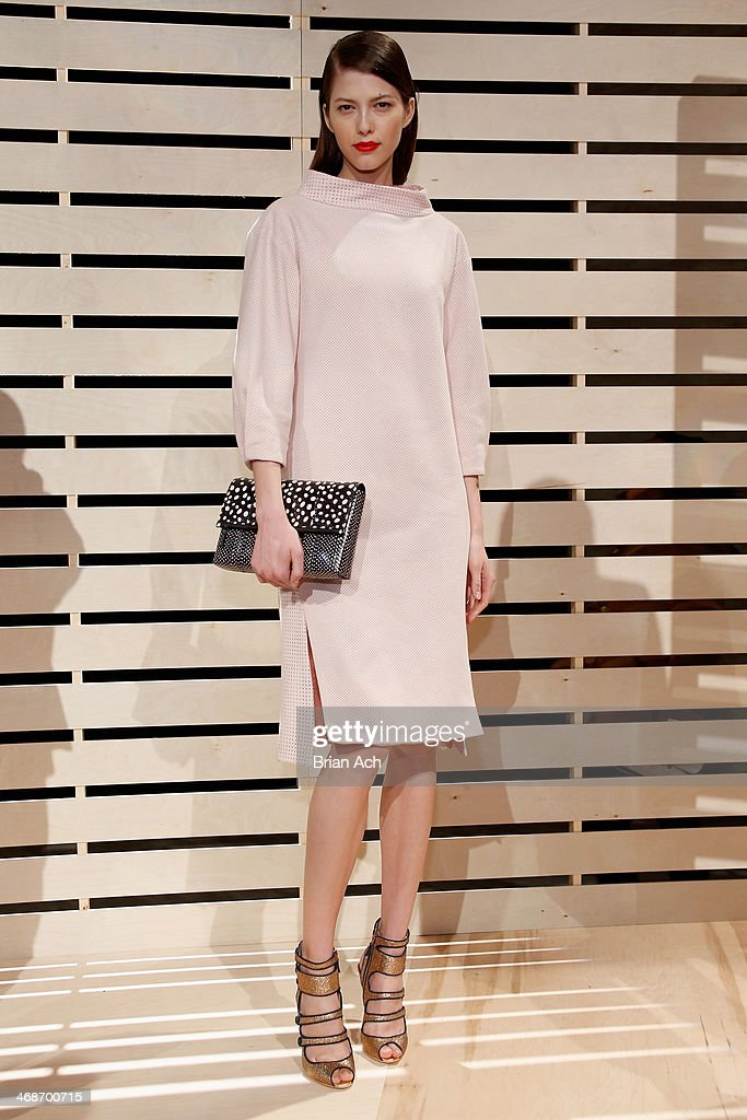 A model poses at the J.Crew presentation during Mercedes-Benz Fashion Week Fall 2014 at The Pavilion at Lincoln Center on February 11, 2014 in New York City.