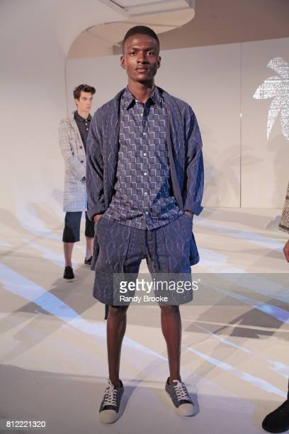A model poses at the Krammer Stoudt presentation during NYFW Men's July 2017 at Dune Studios on July 10 2017 in New York City