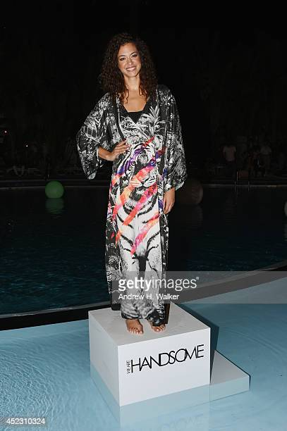 A model poses at the opening party celebrating 10 years during MercedesBenz Fashion Week Swim 2015 at The Raleigh on July 17 2014 in Miami Beach...