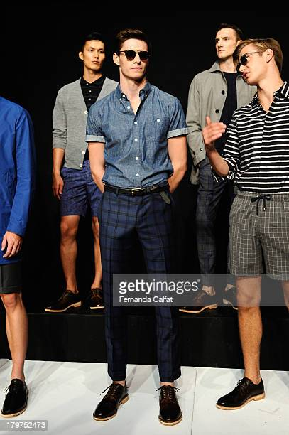 A model poses at the Todd Snyder Spring 2014 fashion presentation during MercedesBenz Fashion Week at The Box at Lincoln Center on September 6 2013...
