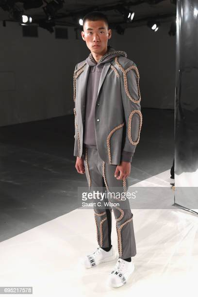 A model poses at the Wan Hung Presentation during the London Fashion Week Men's June 2017 collections on June 12 2017 in London England
