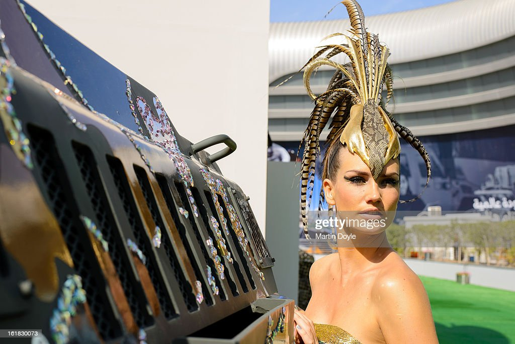 A model poses at the 'World's Toughest Vehicle Gets Couture Fashion Makeover By Paramount Group' at Abu Dhabi National Exhibition Centre on February 17, 2013 in Abu Dhabi, United Arab Emirates. The world's toughest vehicle, Paramount Group's 16 tonne Marauder, has received a couture fashion makeover in response to growing public interest for a consumer friendly version. The vehicle was covered in Swarovski crystals and gold, chrome and bronze camouflage, and accompanied by model in matching ballgown. The makeover was undertaken by Gavin Rajah, couture designer to the stars including Beyonce and Cameron Diaz.