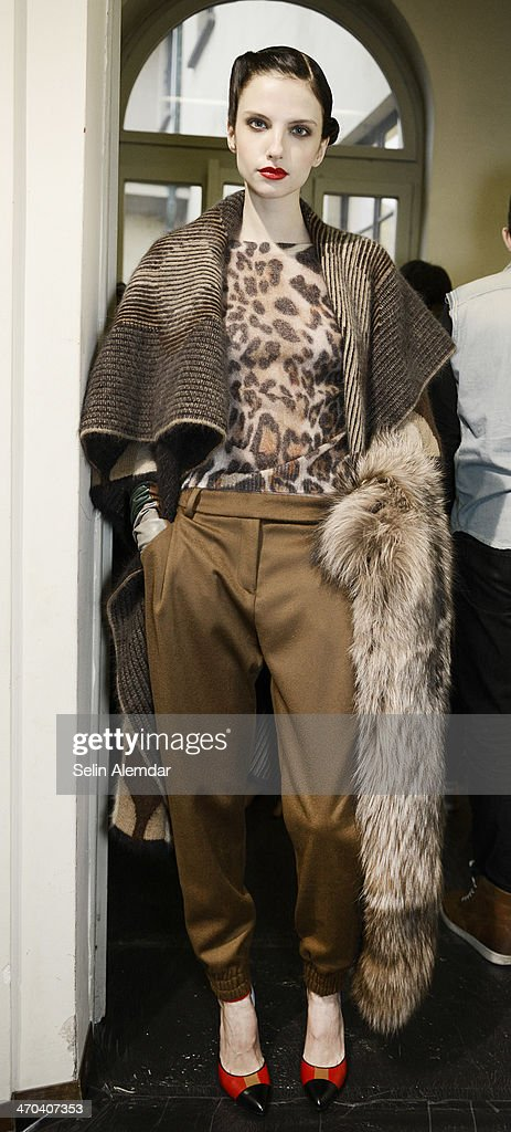 A model poses backstage ahead of Angelo Marani show during Milan Fashion Week Womenswear Autumn/Winter 2014 on February 19, 2014 in Milan, Italy