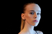 A model poses backstage ahead of the Christopher Esber show during Rosemount Australian Fashion Week Spring/Summer 2011/12 at Overseas Passenger...