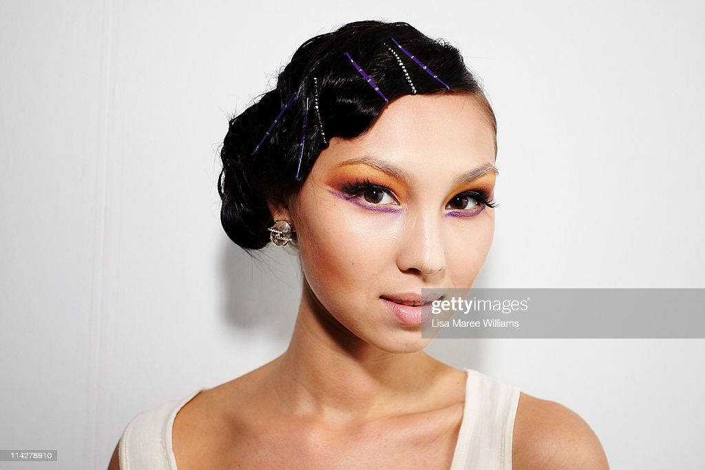 A model poses backstage ahead of the Francis Cheong Couture show during Audi Fashion Festival Singapore 2011 at Tent@Orchard on May 17 2011 in...
