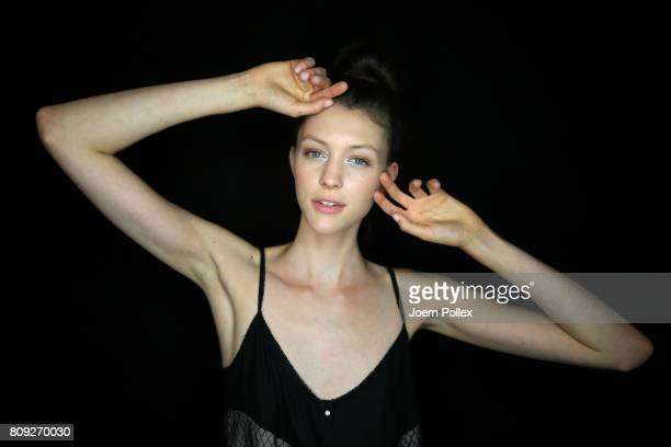 A model poses backstage ahead of the Maisonnoee show during the MercedesBenz Fashion Week Berlin Spring/Summer 2018 at Kaufhaus Jandorf on July 5...