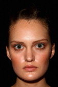 A model poses backstage ahead of the Oroton show on day three of MercedesBenz Fashion Week Australia Spring/Summer 2012/13 at Overseas Passenger...