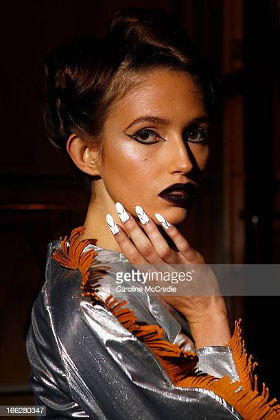 A model poses backstage ahead of the Phoenix Keating show during MercedesBenz Fashion Week Australia Spring/Summer 2013/14 at Carriageworks on April...