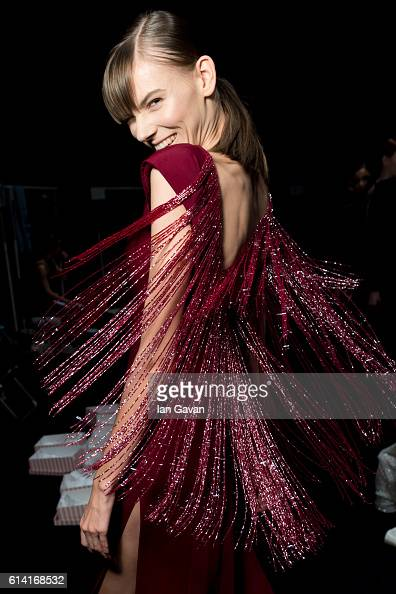 A model poses backstage ahead of the Rasit Bagzibagli show during MercedesBenz Fashion Week Istanbul at Zorlu Center on October 12 2016 in Istanbul...