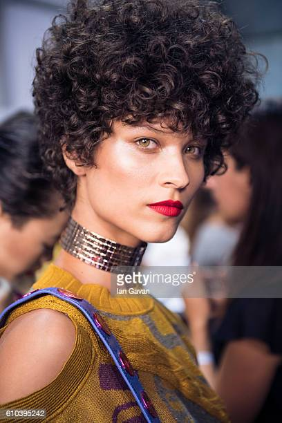A model poses backstage ahead of the Trussardi show during Milan Fashion Week Spring/Summer 2017 on September 25 2016 in Milan Italy