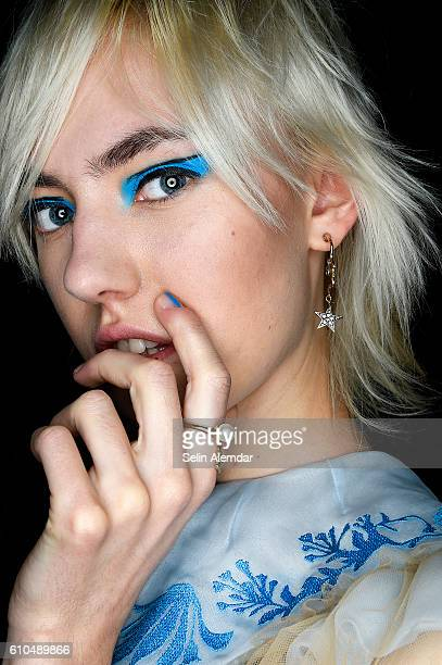 A model poses backstage ahead of the Vivetta show during Milan Fashion Week Spring/Summer 2017 on September 24 2016 in Milan Italy