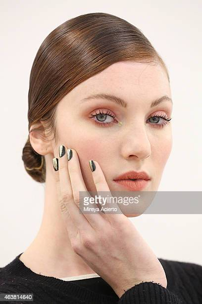 A model poses backstage at Rolando Santana runway show during MercedesBenz Fashion Week Fall 2015 on February 18 2015 in New York City