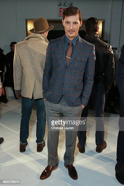 A model poses backstage at the 'Hickey Freeman' presentation at Industria Studios on February 11 2015 in New York City