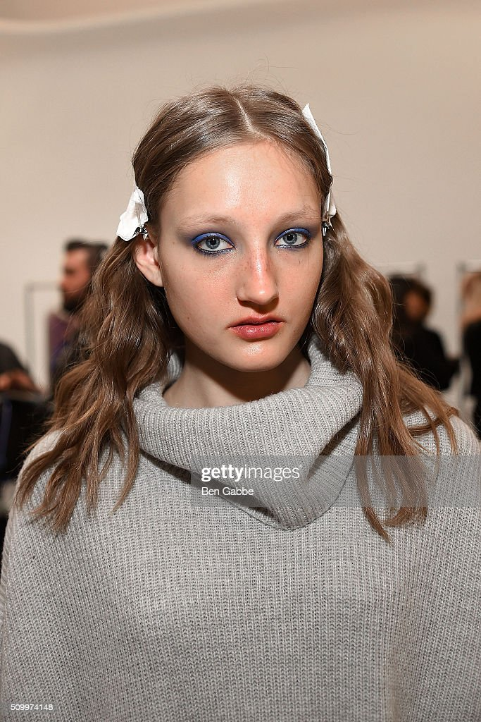 A model poses backstage at the Jill Stuart fashion show during Fall 2016 New York Fashion Week at Industria Superstudio on February 13, 2016 in New York City.