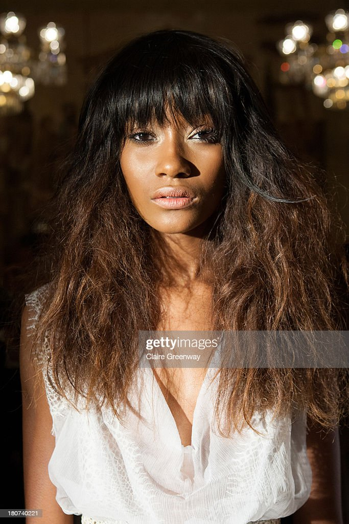 A model poses backstage at the Kristian Aadnevik show during London Fashion Week SS14 at The Royal Horseguards on September 15, 2013 in London, England. The model wears Frontcover Cosmetics.