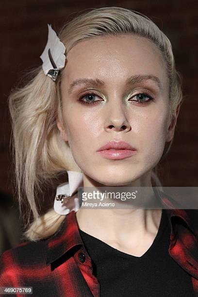 A model poses backstage at the Sass Bide fashion show during MercedesBenz Fashion Week Fall 2014 at The Waterfront on February 12 2014 in New York...