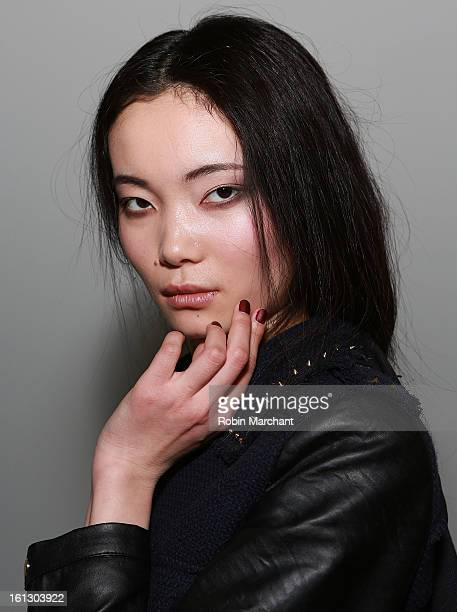 A model poses backstage at the Tibi fall 2013 fashion show during MercedesBenz Fashion Week at Pier 59 on February 9 2013 in New York City
