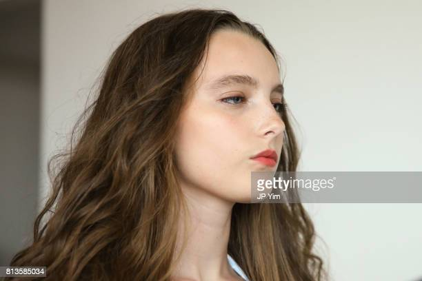 A model poses backstage at Thorsun Men's and Women's Spring/Summer 2018 presentation on July 12 2017 in New York City