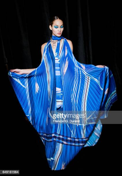 A model poses backstage before the Leonard Paris show as part of the Paris Fashion Week Womenswear Fall/Winter 2017/2018 on March 6 2017 in Paris...