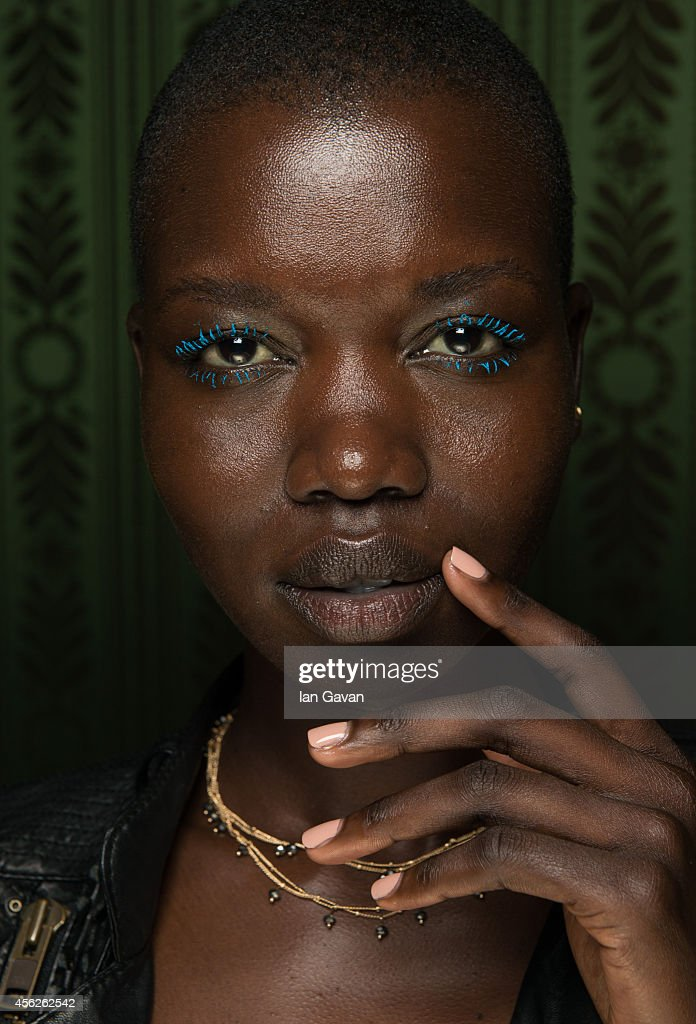 A model poses backstage before the Martin Grant Spring/Summer 2015 show at the Hotel Shangri-La on September 28, 2014 in Paris, France.