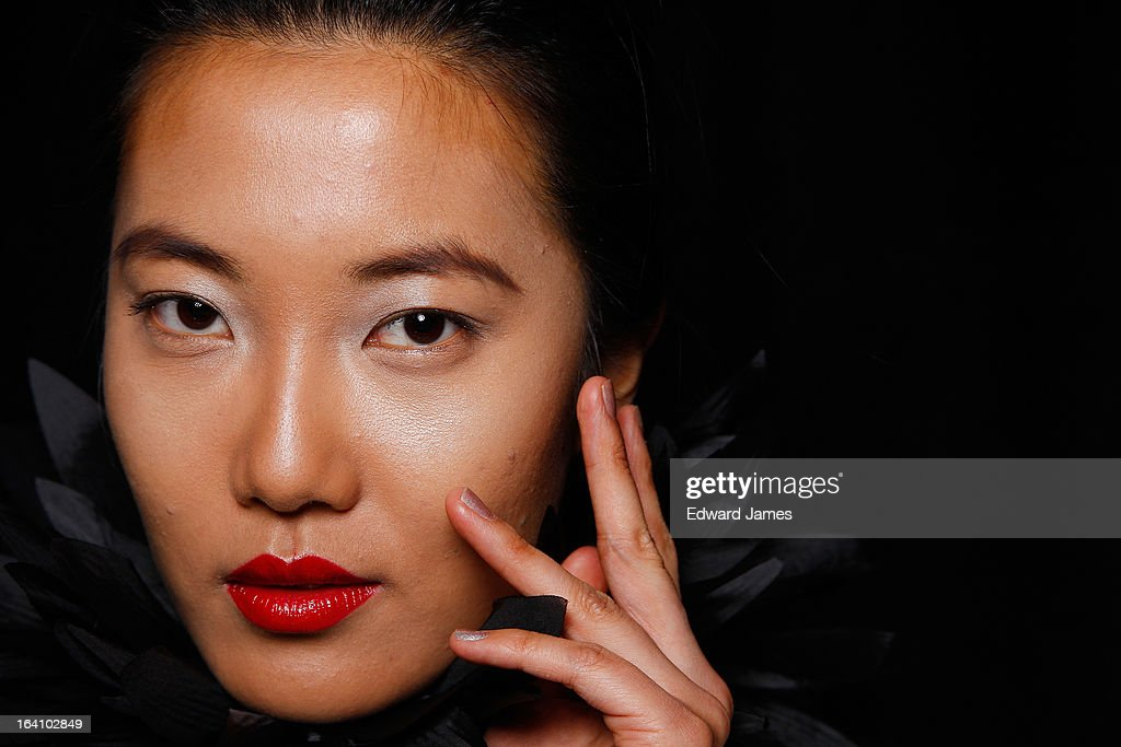 A model poses backstage during David Dixon at David Pecaut Square on March 19, 2013 in Toronto, Canada.
