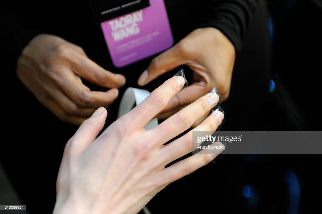 Model poses backstage for fingernail detail at the Michelle Helene Presentationat Pier 59 on February 13, 2016 in New York City.