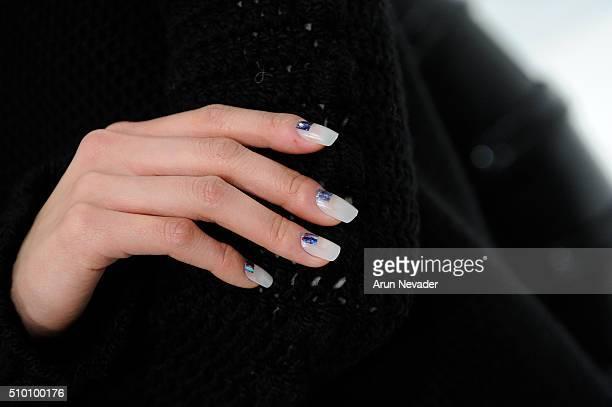 Model poses backstage for fingernail detail at the Michelle Helene Presentationat Pier 59 on February 13 2016 in New York City