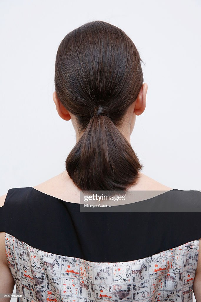 A model poses backstage, hair detail, at the CG fashion show during Fall 2016 MADE Fashion Week at Milk Studios on February 12, 2016 in New York City.