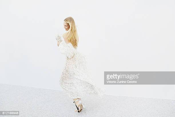 A model poses backstage prior the Giambattista Valli show as part of the Paris Fashion Week Womenswear Spring/Summer 2017 on October 3 2016 in Paris...