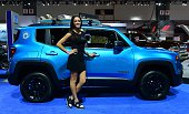 A model poses beside the 2015 Jeep Renegade Riptide at the LA Auto Show's press and trade day in Los Angeles November 20 2014 The LA Auto Show opens...