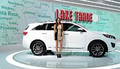 A model poses beside the 2015 Kia Sorento on display at the LA Auto Show's press and trade day in Los Angeles California on November 19 2014 Nearly...