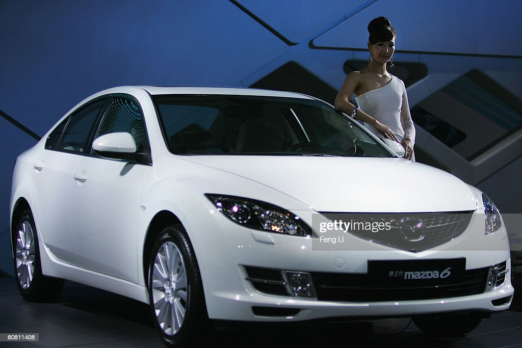 A model poses beside the China premiere Mazda 6 II at a special media opening of the Auto China 2008 show on April 21, 2008 in Beijing, China. The annual auto show is held from 20-28 April. Altogether 890 vehicles, including 55 concept cars, are on show at the new China International Exhibition Center.