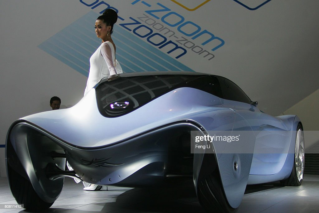A model poses beside the Mazda concept car Taiki during a special media opening of the Auto China 2008 show at the new China International Exhibition Center on April 21, 2008 in Beijing, China. The annual auto show is held from April 20-28 with 890 vehicles including 55 concept cars on show.