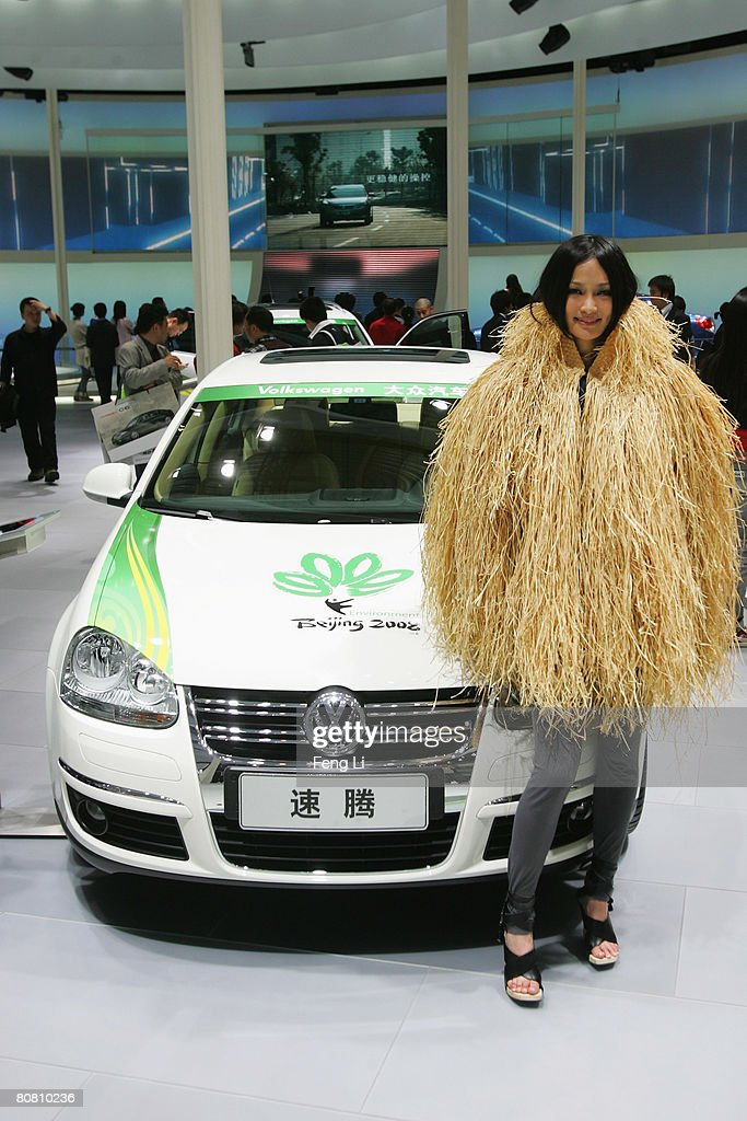 A model poses beside the Volkswagen Sagitar during a special media opening of the Auto China 2008 show at the new China International Exhibition Center on April 21, 2008 in Beijing, China. The annual auto show is held from April 20-28 with 890 vehicles including 55 concept cars on show.