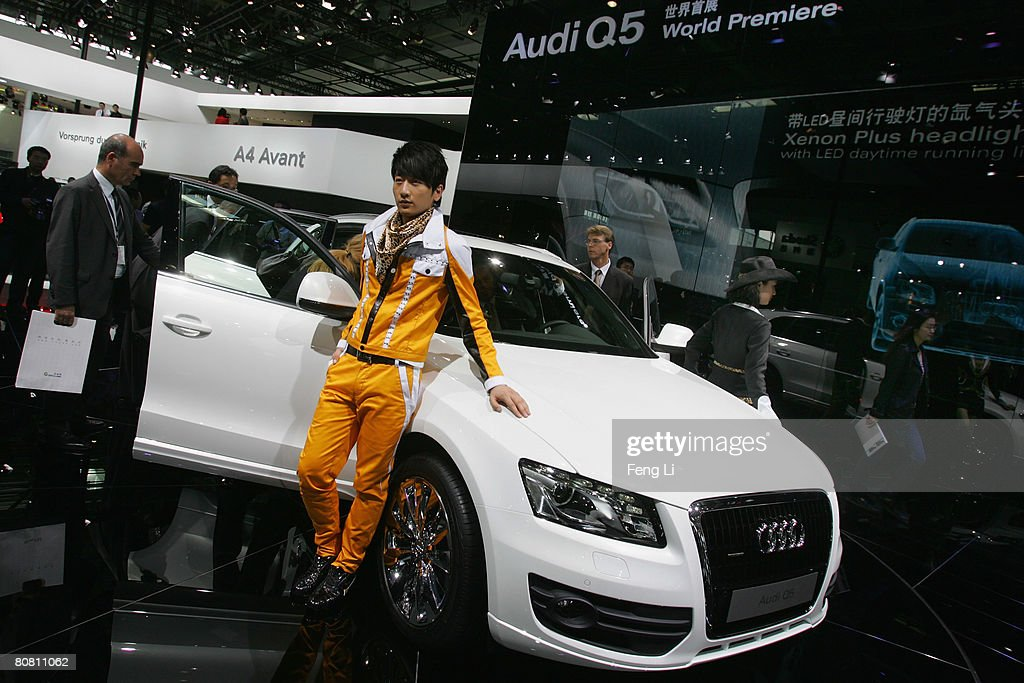 A model poses beside the world premiere display of the Audi Q5 during a special media opening of the Auto China 2008 show at the new China International Exhibition Center on April 21, 2008 in Beijing, China. The annual auto show is held from April 20-28 with 890 vehicles including 55 concept cars on show.