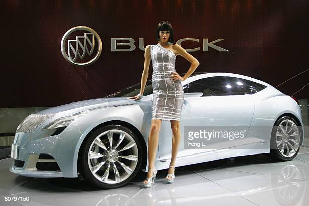 A model poses beside the world premiere display of the Buick concept car Riviera during a special media opening of the Auto China 2008 show at the...