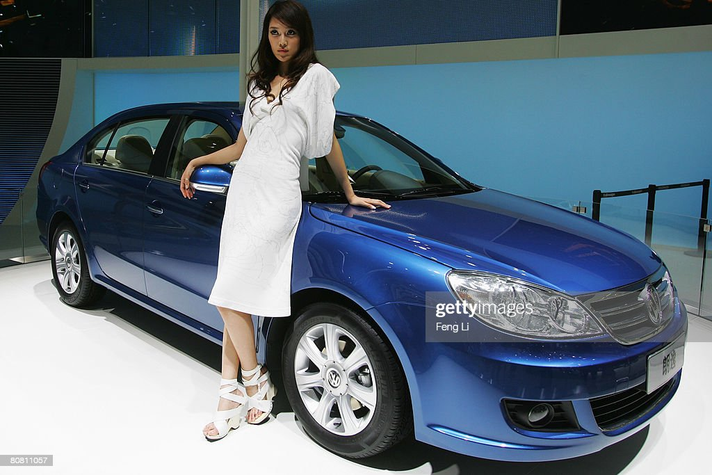 A model poses beside the world premiere display of the Volkswagen Lavida during a special media opening of the Auto China 2008 show at the new China International Exhibition Center on April 21, 2008 in Beijing, China. The annual auto show is held from April 20-28 with 890 vehicles including 55 concept cars on show.