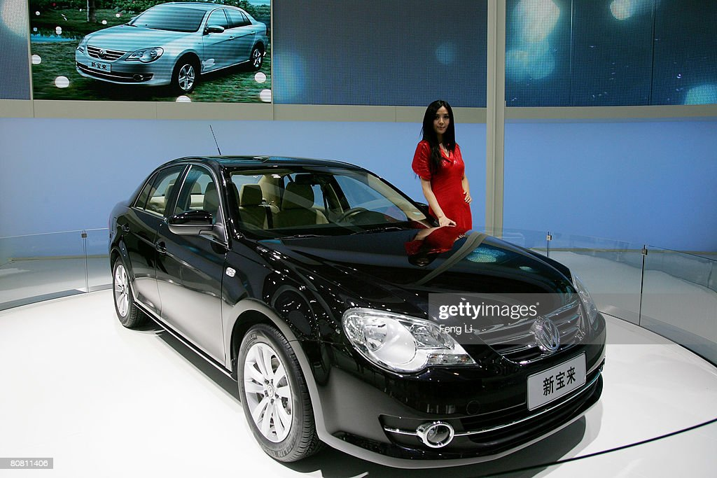 A model poses beside the world premiere display of the Volkswagen new Bora during a special media opening of the Auto China 2008 show at the new China International Exhibition Center on April 21, 2008 in Beijing, China. The annual auto show is held from April 20-28 with 890 vehicles including 55 concept cars on show.