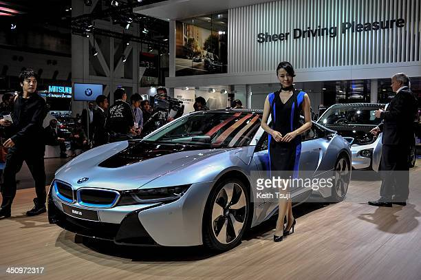 A model poses by the BMW i8 electric concept vehicle during the 43rd Tokyo Motor Show 2013 at Tokyo Big Sight on November 20 2013 in Tokyo Japan The...