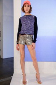 A model poses during the Juicy Couture spring 2014 presentation at Milk Studios on October 8 2013 in New York City