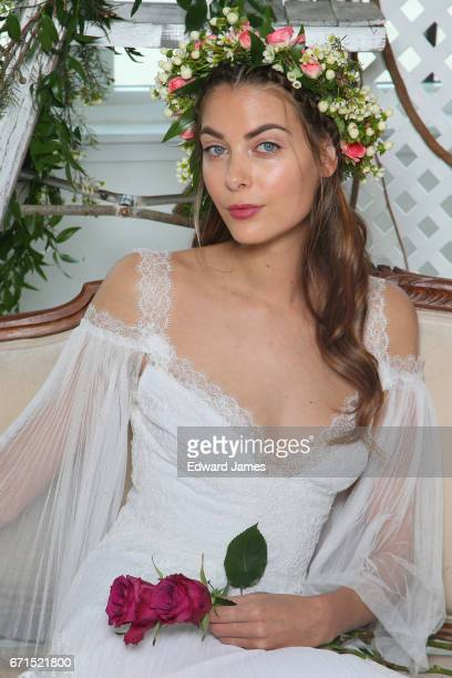 A model poses during the Marchesa Spring/Summer 2018 Couture Bridal presentation at Canoe Studios on April 20 2017 in New York City