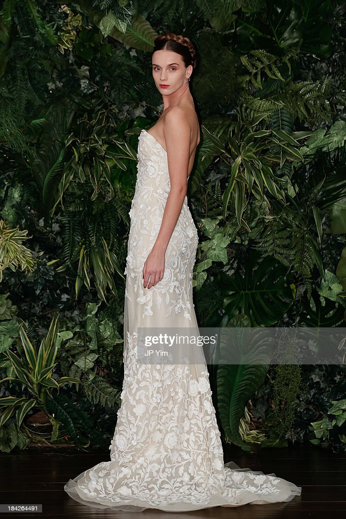 A model poses during the Naeem Khan Fall/Winter 2014 Bridal Collection presentation and reception on October 12, 2013 in New York City.