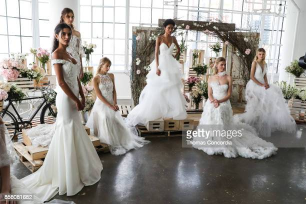 A model poses during the presentation of Marchesa Bridal Collection Fall 2018 at Canoe Studios on October 5 2017 in New York City