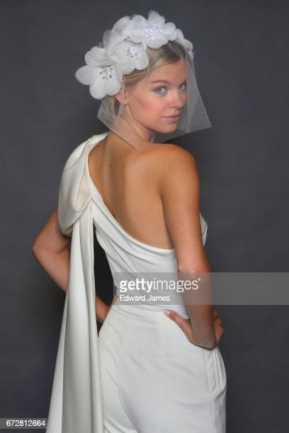A model poses during the Viktor Rolf Mariage Spring/Summer 2018 collection presentation on April 24 2017 in New York City