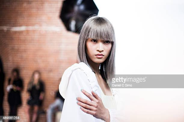 A model poses for a photo backstage at the Tibi SS16 show part of New York Fashion Week Spring/Summer 2016 on September 12 2015 in New York City