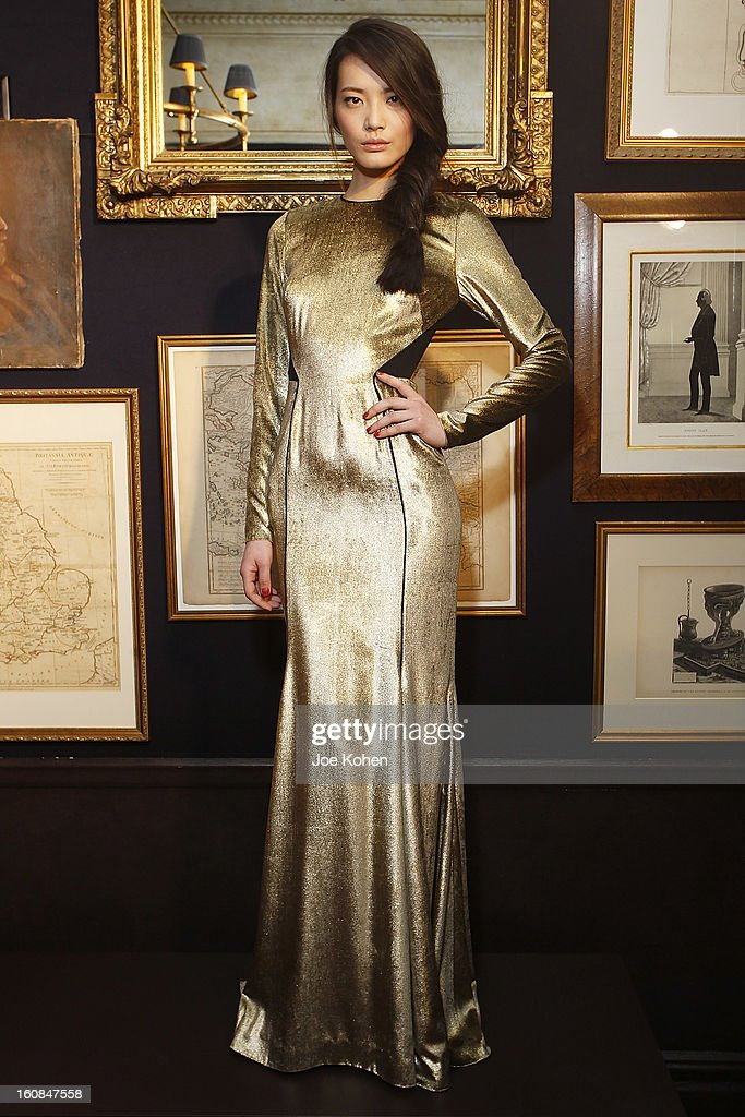 A model poses for a photo during the Veronica Beard fall 2013 presentation during Mercedes-Benz Fashion Week at Bill's on February 6, 2013 in New York City.