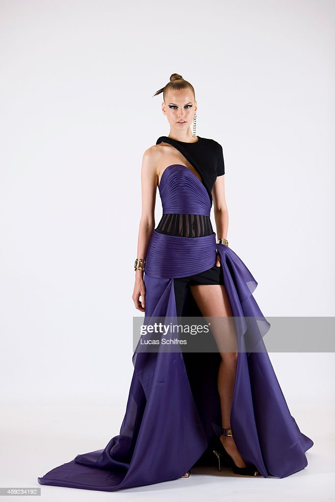 A model poses for a photograph before the presentation of Versace Autumn Winter 2014 fashion show during Paris Haute Couture Fashion Week on July 5, 2014 in Paris, France.