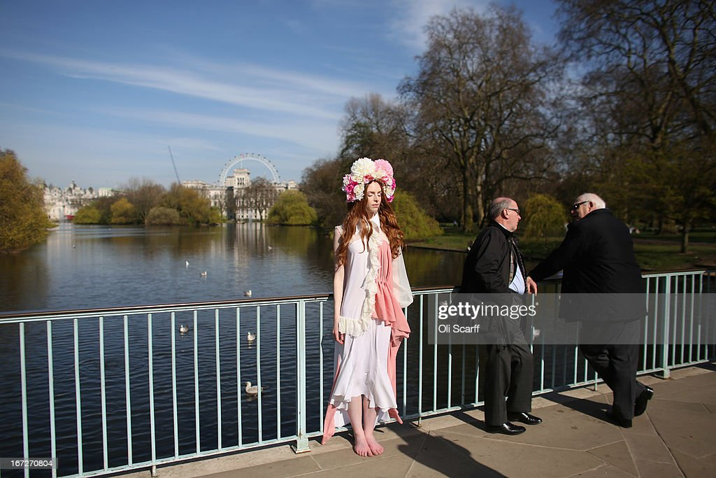 A model poses for a photograph on a footbridge in St James's Park in warm Spring weather on April 23, 2013 in London, England. Following an unseasonably cold start to 2013 temperatures across the UK are beginning to increase.