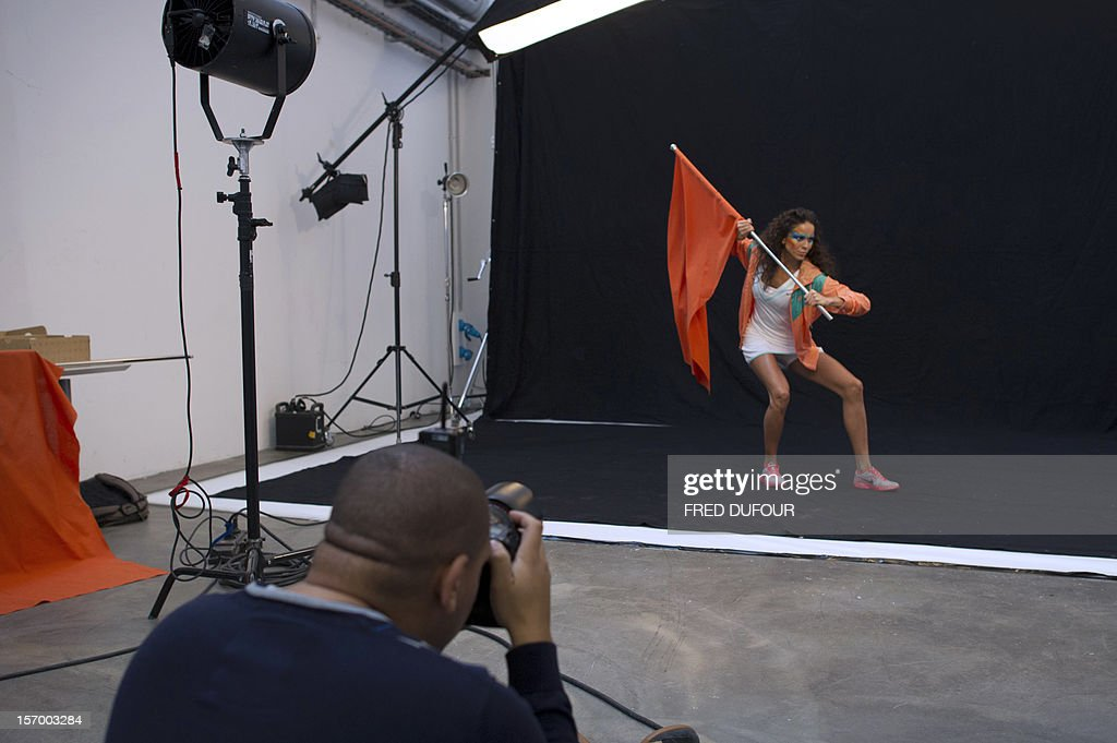 A model poses for a photographer on November 27, 2012 in Saint-Denis, north of Paris, at the headquarters of vente-privee.com, ahead of the Christmas and new Year celebrations. The vente-privee.com storage facilities celebrates its 10th anniversary.
